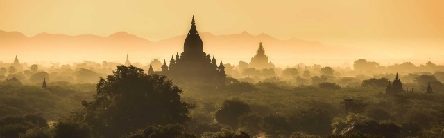 Myanmar Landscape, temples and forest at sunset