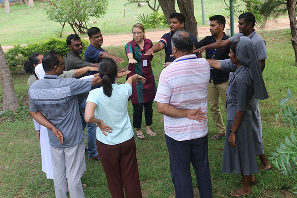 Participants in outdoor circle activity