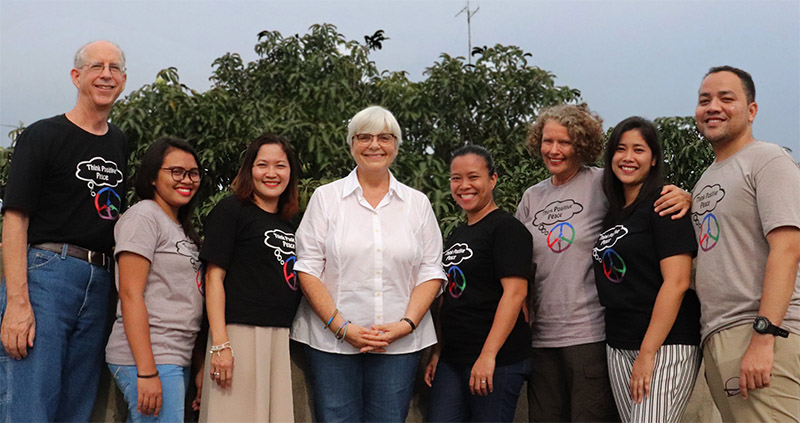 MPI Team outside in front of a mango tree
