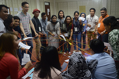 Group holding a net of strings