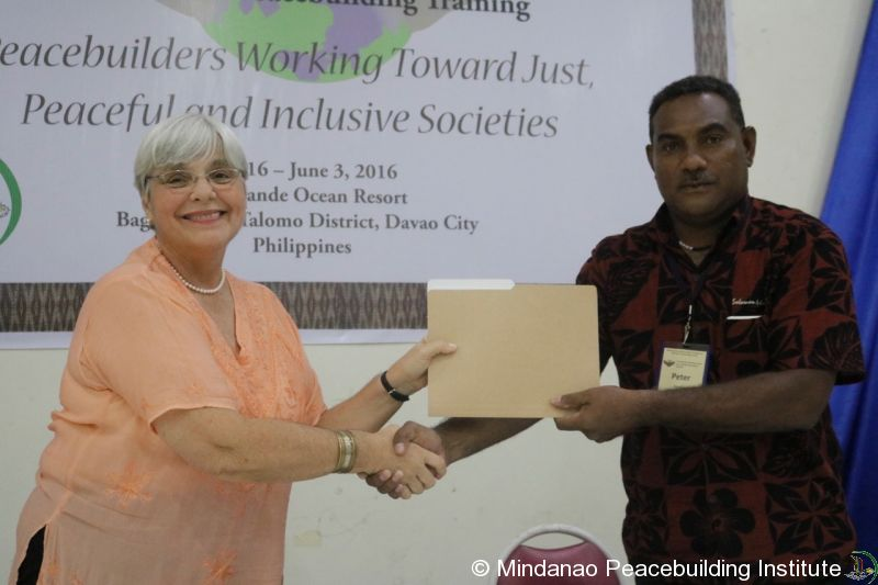 MPI Director Christine Vertucci and Peter Mae, Undersecretary of the Solomon Islands' Ministry of National Unity Reconciliation and Peace (MNURP)
