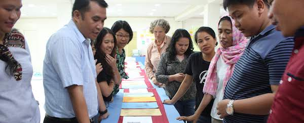 Grassroots Peacebuilding Mentors looking at table with cards during an activity