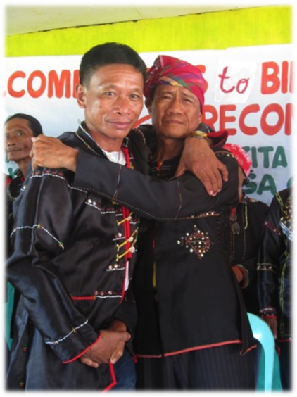 Barangay Captain Luciano Tanglanan and Datu Dalepusan Isis embracing each other
