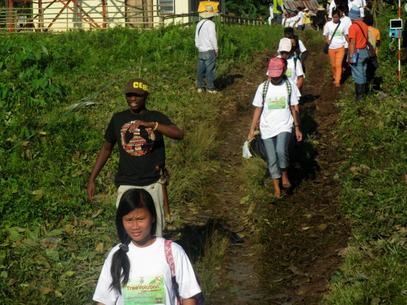 Particpants walking to their respective assignment for tree planting