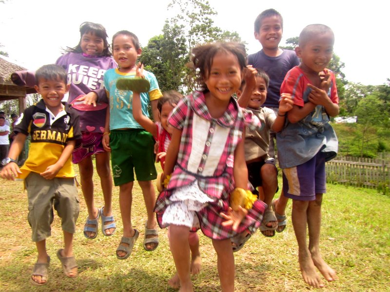 Subanen children jumping for joy during the tree planting
