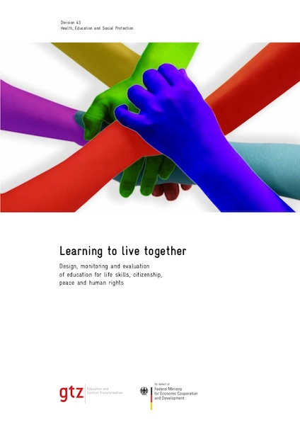 Learning to live together cover - colored hands joined together